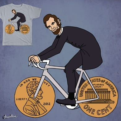 Abe Lincoln Riding Bike With Penny Wheels