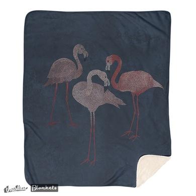 Three pink flamingos on navy blue