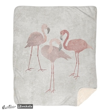 Three pink flamingos on beige