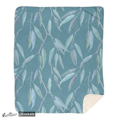 Eucalyptus leaves on blue